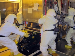 Workers separate a glove box for removal from Hanford's Plutonium Finishing Plant.