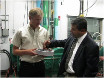 ARPA-E Director Dr. Arun Majumdar and MSU Project Lead Dr. Norbert Mueller test the wave disk engine.