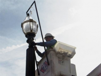 A worker installs energy-saving streetlights on Colorado Avenue. | Photo courtesy of Springs Sustainability