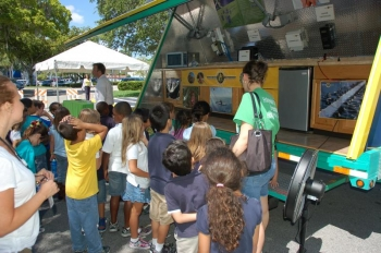 Elementary school students look over a solar demonstration trailer. | Photo courtesy of the City of Hollywood, FL