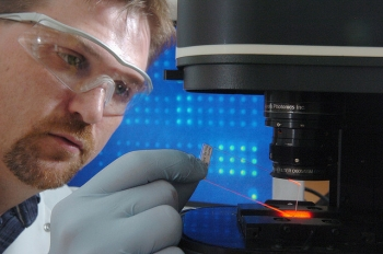 Biochemist Dan Schabacker uses microbial forensics technology -- using proteins in microbes to get clues about how they were created -- to detect where organisms, such as anthrax spores, came from.   Courtesy of Argonne National Laboratory
