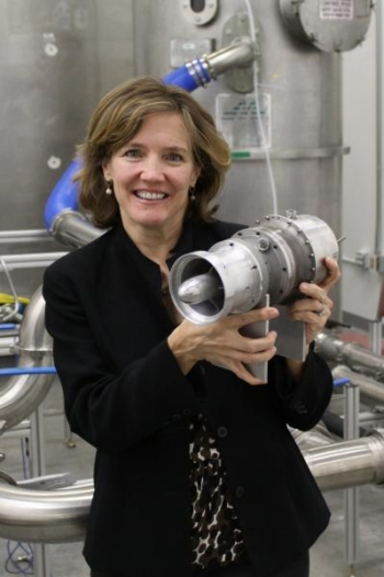 Shirley Coates Brostmeyer holds FTT's twin-spool turbofan, the most efficient micro-turbine of its size | credit Frank Serio