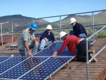 Participants in the Energy Department's Train-the-Trainers program in the Rocky Mountain region take part in a roof-mount solar panel install lab exercise at Solar Energy International's PV Lab Yard in Paonia, CO, in the summer of 2010.   Photo courtesy of Solar Energy International