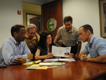 Judith Mondre meets with members of the Mondre Energy team.   Photo courtesy of Judith Mondre