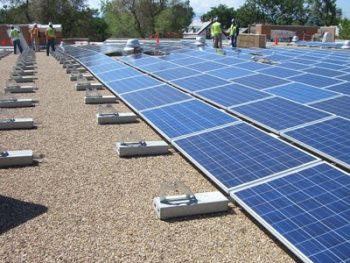Workers install a solar photovoltaic system on the roof of a Denver school.| Photo courtesy of Main Street Power