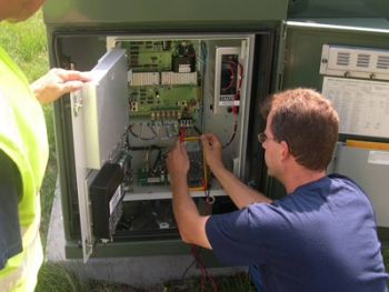 Technicians implement smart meters as part of the Naperville Smart Grid Initiative, which is projected to save the city $3 million a year over a 15 year period. | Photo courtesy of Naperville