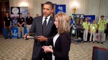 The President looks at a model solar car built by Mikayla Nelson of Montana, White House Photo, Chuck Kennedy, 10/18/10