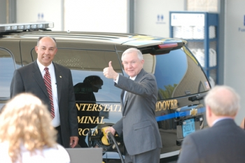 Mayor Petelos and Senator Jeff Sessions filling up a Hoover Police Tahoe with certified fuel made from Hoover's very own wood-waste last year. | Photo courtesy of Lori Salter |