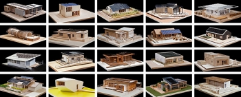Models of the homes that this year's competitors have designed, built, and will operate at the Solar Decathlon.