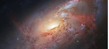 Science fiction has envisioned many ways that mankind might be able to explore distant galaxies, like the spiral galaxy M106 pictured here, but what is science fiction and what could one day be science fact? | Photo Credit: NASA.