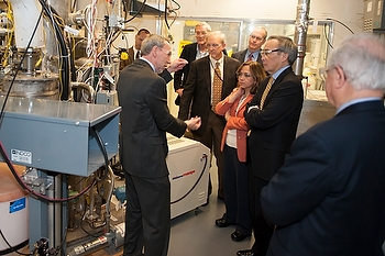 Dave Huizenga, head of EM, fifth from right, and Secretary of Energy Steven Chu, second from right, participate in a tour of Catholic University's Vitreous State Laboratory this week.