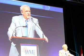 EM Senior Advisor Dave Huizenga speaks during the plenary session of the Waste Management Conference in Phoenix today.