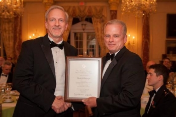 EM Senior Advisor Dave Huizenga, left, receives the Presidential Rank of Distinguished Executive award from Eric Coulter, treasurer of the board of directors for the Senior Executives Association, which sponsors the awards program.