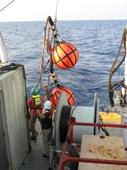 USGS technicians Eric Moore and Jenny White deploy instruments at the start of a seismic survey to explore gas hydrates in the deepwater Gulf of Mexico from April to May 2013 | Photo courtesy of USGS