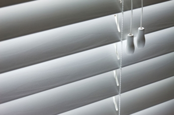 Blinds are a great option for cooling your home in the summer. | Photo courtesy of ©iStockphoto/nycshooter