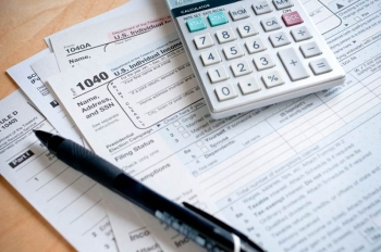 Report your qualifying energy-efficient home upgrades on your 2013 tax forms. | Photo courtesy of ©iStockphoto.com/Tsuji