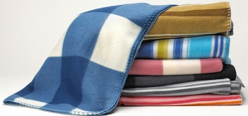 Homemade blankets can make easy and highly personalized gifts. | Photo courtesy of ©iStockphoto.com/NAKphotos