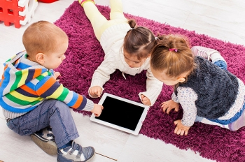 We can still teach our children to make environmentally friendly choices in a world of quickly advancing technology. | Photo courtesy of ©iStockphoto.com/boggy22