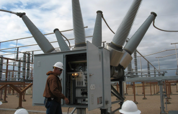 An electrician foreman for the Western Area Power Administration checks a circuit breaker at the Ault Substation in eastern Colorado.  The circuit breaker, containing 85 lbs of SF6, protects equipment in the substation against damage from excessive electrical currents   Courtesy of Western Area Power Administration.