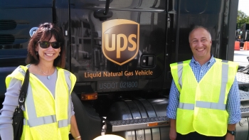Wanda Forrest, Coordinator of the Northern Florida Clean Fuels Coalition in Jacksonville, and Mike Scarpino, of Clean Cities, standing next to a compressed natural gas vehicle. | Photo courtesy of Clean Cities