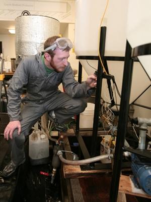 Zach Waickman works on a biodiesel project at Loyola University. | Photo courtesy of Mark Beane, Loyola University