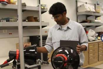 UCSD Ph.D. candidate (structural engineering) and von Liebig Fellow Arun Manohar demonstrates unique Enhanced Infrared Thermography algorithm to identify structural defects in composite wind turbine plates.   Image Courtesy of the San Diego Renewable Energy Fellowship.