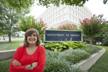"""The author, pictured outside the Department of Energy's headquarters in Washington, D.C.   Photo by <a href=""""/node/379579"""">Sarah Gerrity</a>, Energy Department."""
