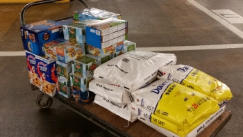 Javed Zaidi, who works in the Energy Information Administration (EIA), has filled his truck with food to be donated for the past four years of Feds Feed Families. This year's haul included rice, cereal, fruit cups, sugar and macaroni and cheese. | Photo courtesy of Javed Zaidi.