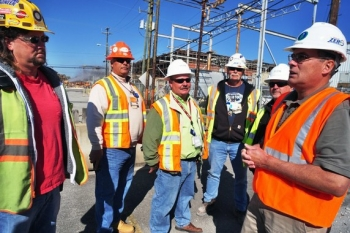 Jim (far right) talks with workers at the K-25 demolition site.