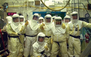 Team members gather for a photo after safely and successfully completing a complicated glove box separation.