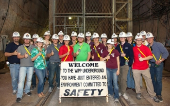 A group of Texas A&M University nuclear engineering students shows enthusiasm for WIPP's underground operations in May 2013.