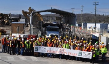 Employees with the K-25 demolition team gather for a photo following the completion of demolition of the north end of the K-25 Building today.