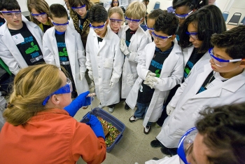 An LBNL scientist explains the properties of liquid nitrogen to students on Bring Your Sons and Daughters to Work Day. | Courtesy of Lawrence Berkeley National Lab | Credit: Roy Kaltschmidt.