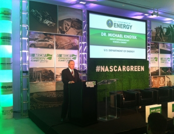 Dr. Michael Knotek, Deputy Undersecretary for Science and Energy at the Energy Department, delivers remarks at the NASCAR Green Summit in Chicago, where the DOE-NASCAR MOU was announced.   Photo courtesy of NASCAR.