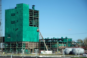 Workers remove panels from the Metals Plant in September 2012.