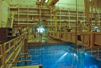 The Society of American Military Engineers highlights this Idaho site photo on the cover of the latest issue of its publication, The Military Engineer. In the photo, work is under way to move spent nuclear fuel from wet storage to the safer, more permanent alternative of dry storage.