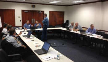 Participants discuss facility data and their steam models. <em>Image courtesy Land O' Lakes.</em>