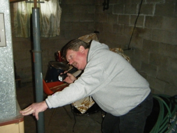 Mark Morris inspects a furnace. | File photo