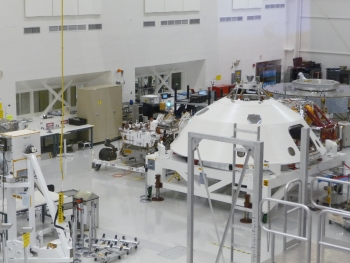 Curiosity, left, at NASA's Jet Propulsion Laboratory in Pasadena, California, in late November 2011. Shown here is the flight hardware that was being assembled prior to shipment to Cape Canaveral Air Force Station in Florida for the launch. | Photo Credit Dr. Robert C. Nelson