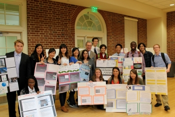 """Students from the University of Maryland's """"Designing a Sustainable World"""" class (Spring 2013),  display their end projects. The course used the <a href=""""http://www1.eere.energy.gov/education/energy_101.html"""">Energy 101</a>, peer reviewed course framework using the energy literacy principles for higher education. The general education course encouraged students from varying majors to think critically about energy consumption and conservation in their daily lives. More than 90% of the students indicated that the course, which culminated with end-of-semester design projects, helped them understand the complex issues and problems surrounding energy. The University of Maryland hopes to offer future courses that use the Energy Literacy Principles.  