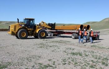 Poles for the Montana-Alberta Tie Line are unloaded outside Shelby, Mont.   Photo courtesy of Tonbridge Power