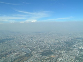 A heavy layer of air pollution, a mix of aerosol particles and vapors, obscures the view over Mexico City. Two studies by the Pacific Northwest National Laboratory show the importance of including the small-scale effects of aerosols in climate modeling. | Image courtesy of PNNL