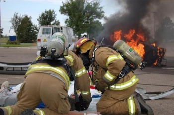 In a mock scenario, firefighters work with an accident victim during a Transportation Emergency Preparedness Program full field exercise