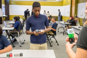"""A student from from Chicago's Laura S. Ward STEM School learns to use computational thinking during <a href=""""http://www.anl.gov/articles/inspiring-next-generation-computational-thinkers"""">My Brother's Keeper's visit to Argonne National Lab.</a> 