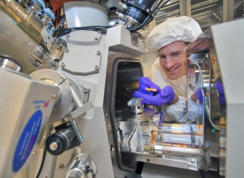 Kim Kisslinger, a researcher at Brookhaven Lab's Center for Functional Nanomaterials seen here with a focused-ion beam instrument, reduced the indium gallium nitride (InGaN) samples to a thickness of just 20 nanometers to prepare them for electron microscopy. | Photo courtesy of Brookhaven National Laboratory.