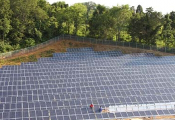 Efficient Energy of Tennessee installs panels at a 1-MW solar farm outside Knoxville in July. | Photo by Harvey Abouelata and courtesy of Efficient Energy of Tennessee