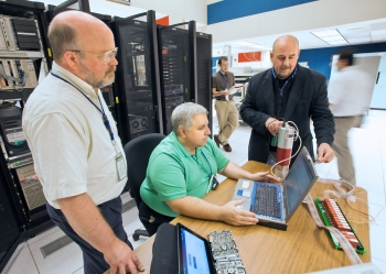 Charles Gentile (center) and other members of the MINDS team, including Ken Silber (right) and Bill Davis (left) work on new techniques to identify radionuclides. | Photo by Elle Starkman/Princeton Plasma Physics Laboratory Office of Communications