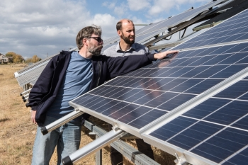 Researchers monitor the progress of the new photovoltaic array at the National Renewable Energy Laboratory. Photo Courtesy   National Renewable Energy Laboratory