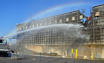 Crews tear though the final wall of Building K-25, bringing an end to the five-year demolition project.