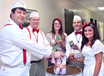 """Oak Ridge Integrated Support Center employees Josh Clark (from left), Steve Martin, Katelynn Prutsman, Tom Rizzi and Hailey Beeler gave employees ice cream from a make-shift """"ice cream truck"""" in exchange for non-perishable items. They even dressed the part! 